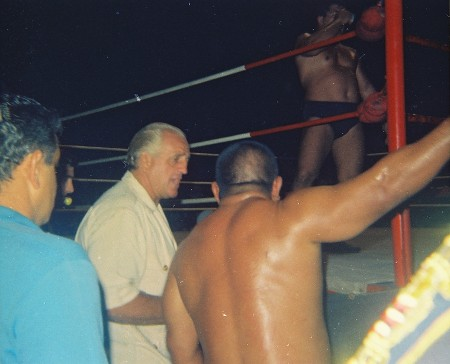 Kenji Shibuya complains to announcer Lord Blears.