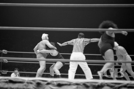 The Link has his bear hug on Fred Blassie as Ripper Collins rushes to Blassie's aid.