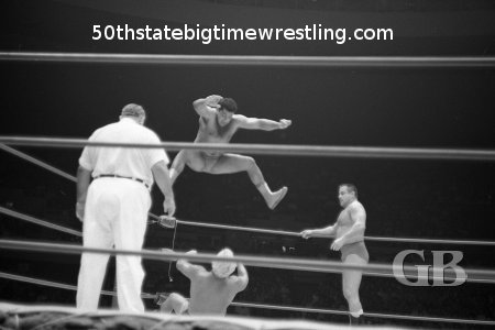 Pedro Morales comes off the top ropes onto a horrified Angelo Poffo.