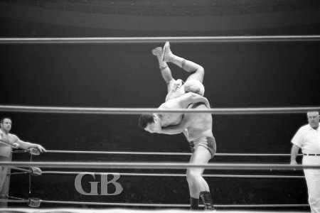 Angelo Poffo about to body slam Pedro Morales.