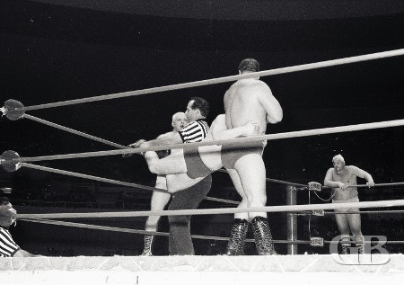 Billy Watts drags Patt Patterson away from the ropes as Ray Stevens objects to the ref.