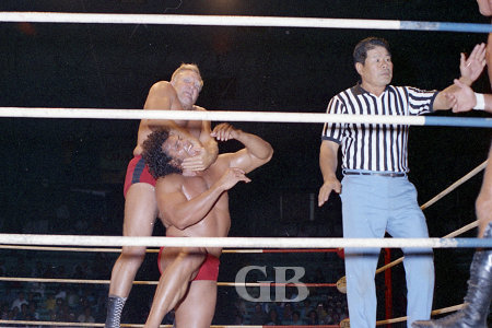 Jack Bence applies a punishing Chin Lock on Jimmy Snuka.