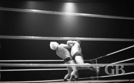 Jim Hady collides with a stunned Angelo Poffo.