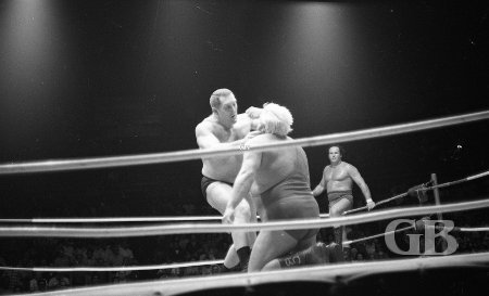 Karl Gotch rearranges Collins' face.
