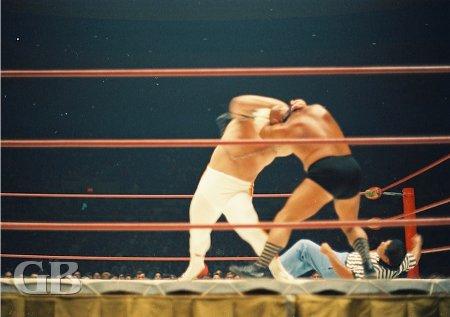 referee Wally Tsutsumi takes a tumble