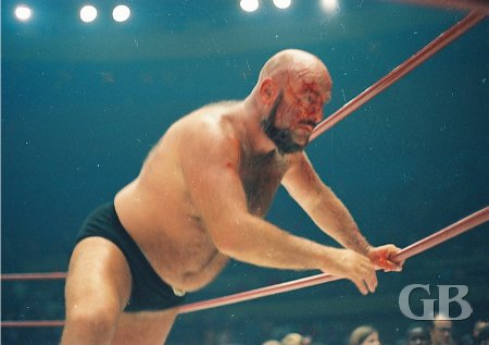 A bruised and bleeding Maddog Vachon