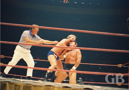 The Sheik chomps a mouthful from Johnny Barend's forehead