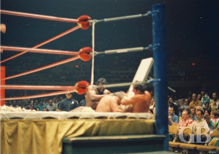 Johnny Barend lofts a ringside table onto the Sheik