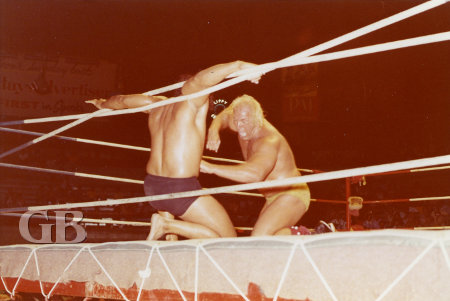 Superstar punches away at a rope entangled Jimmy Snuka.