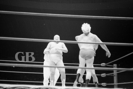 Pepper Gomez takes on both opponents in the middle of the ring.