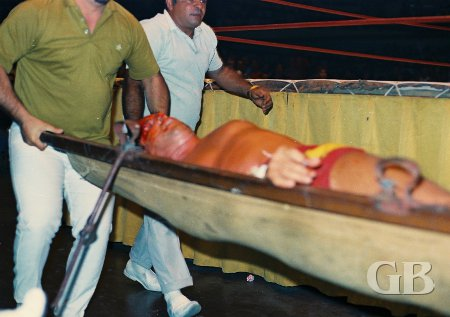 Johnny Barend being carried out of the ring on a stretcher