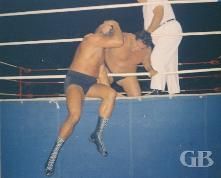 Curtis Iaukea returns the favor by slamming Enrique Torres' head into the apron.