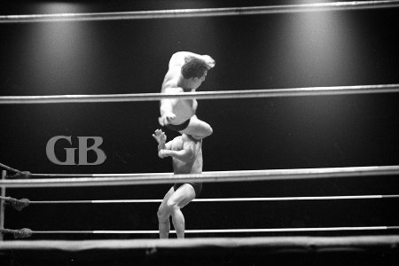 Jim Hady catches Odd Job on the kisser with his Flying Drop Kick.