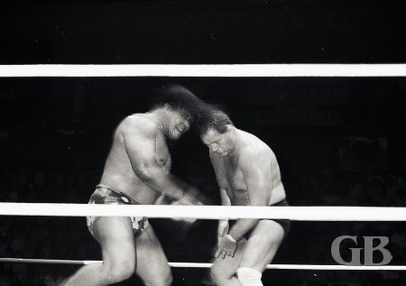 Peter Maivia headbutts Jerry London.
