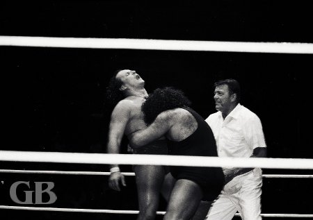 Referee Pete Peterson watches Johnny Barend carefully as the Missing Link looks for a submission with his Bear Hug.