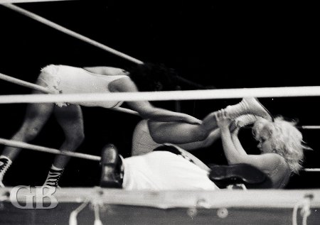 The Fabulous Moolah reaches through the ropes to break up Joyce Grable's pin attempt on Betty Boucher.