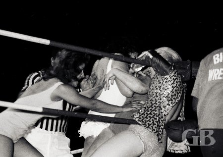 Betty Boucher (left) and Moolah attack Grable and Sherry before the match begins.
