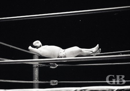 Peter Maivia relaxes on the ropes in his corner as he awaits Curtis Iaukea's entry into the ring.