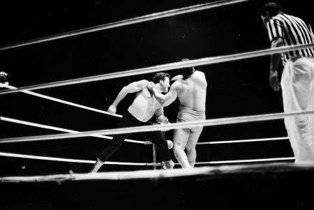 Pedro Morales chops Rocky Montero.
