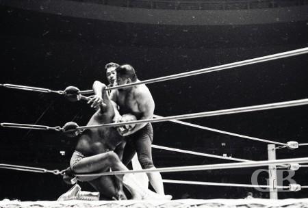 Kenji Shibuya punishes Bearcat Wright in the corner as referee Wally Tsutsumi looks on.