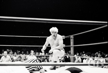 Ray Stevens takes a breather as both Jim Hady and the referee lay face down in the ring.