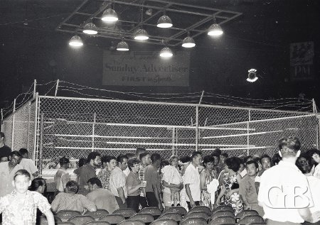 The sellout crowd leaves the Civic after the match. Note the barbed wire on top of the cage walls.