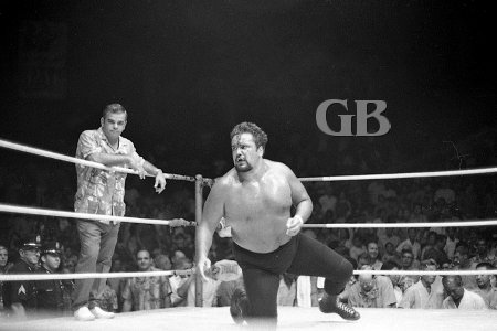 A bleeding and battered Iaukea watches as Pedro wins the Hawaiian Championship belt.