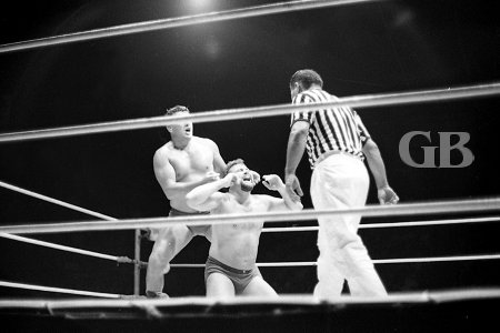Billy Robinson releases a nerve hold on Tommy Andrews as referee Wally Tsutsumi watches.