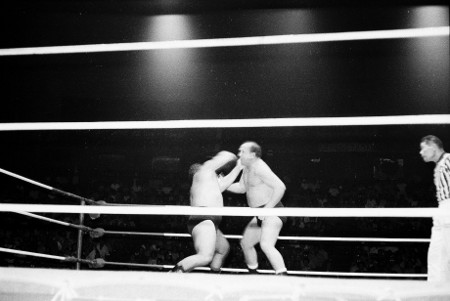 Hady and Kox battle it out in the middle of the ring referee Wally Tsutsumi watches.