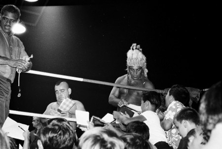 Chief Billy White Wolf signs autographs with his tag partners Little Beaver and Joey Russell.