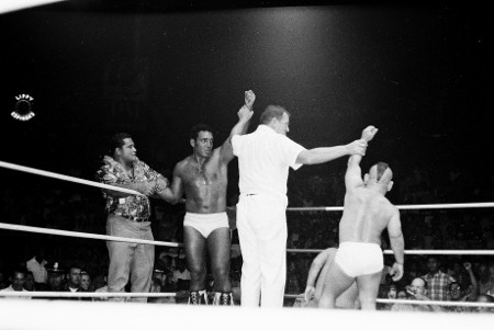 Peter Maivia watches as Referee Pete Peterson declares Chief Billy White Wolf's team the winners.