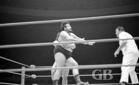 Peter Maivia about to flip Curtis Iaukea over with a side belly to belly suplex.