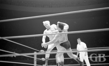Both men get slammed together in the middle of the ring.