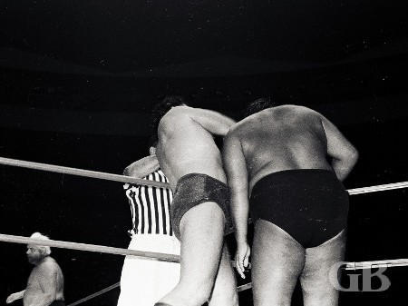 Johnny Barend works over Curtis Iaukea in the corner outside the ring.