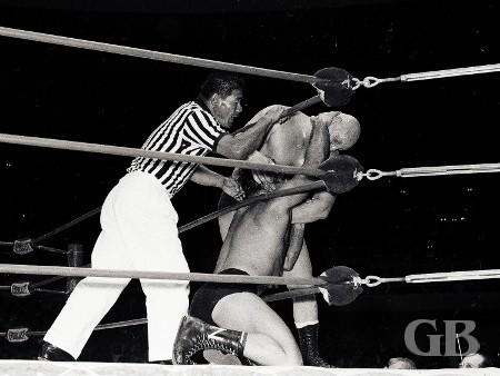 Skull Murphy has Nick Kozak in the corner as referee Wally Tsutsumi intrudes