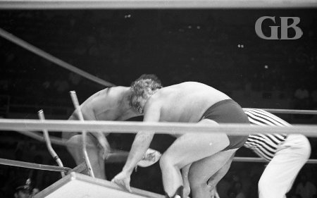 The Sheik drags in a table from outside the ring.