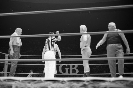 Ray Stevens (behind referee) and Patt Patterson confront each other before the match