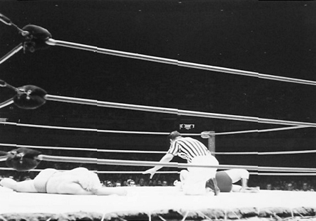 Referee Wally Tsutsumi counts Pat Patterson