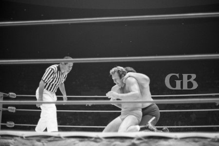Monsoon applies a painful Nerve hold onto Nick Bockwinkel's neck and shoulders