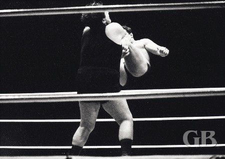 Jim Hady lands a drop kick on George Harris.