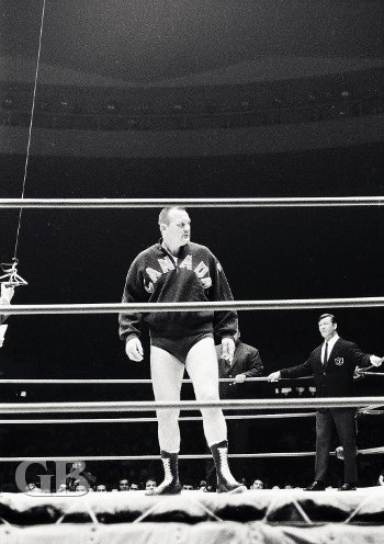 World Champion Gene Kiniski looks over the crowd as promoter Ed Francis watches.
