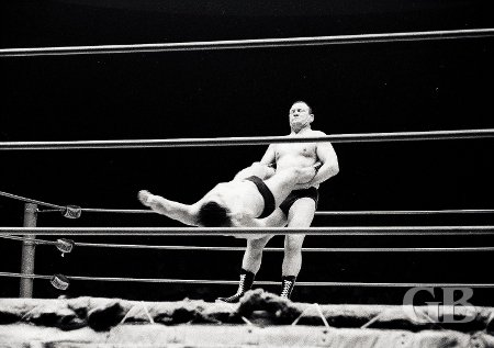 Gene Kiniski grabs Jim Hady by the legs in preparation for the Boston Crab submission hold.