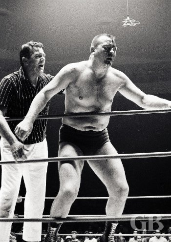 Gene Kiniski, with his head split open, retains the World Championship.