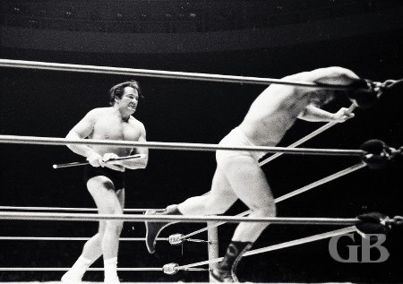 Maurice charges after Dino Lanza with his cane.