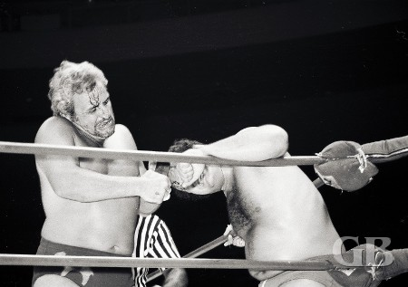 A bloody Sheik continues to work over Fred Curry