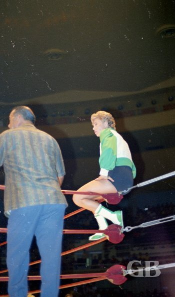 A relaxed Toni Rose sits on the top turnbuckle