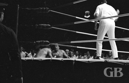Johnny Barend and Dutch Schultz are counted out of the ring.