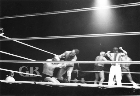 Mayhem in the ring as all four wrestlers battle in the ring at the same time.