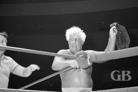 A disgusted Fred Blassie tries to steal the North American belt after losing the match.