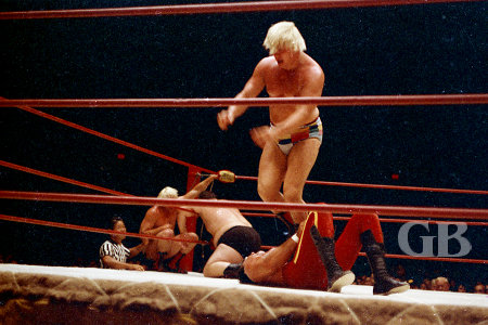 Pat Patterson stomps on Johnny Barend while Ray Stevens works over Gorilla Monsoon in the background.